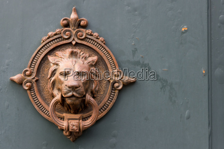 antique door knocker with lion head