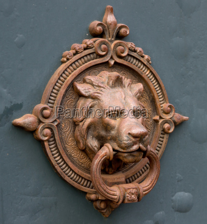 ancient iron doorknockerlions head