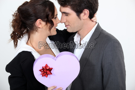 couple holding heart shaped box of
