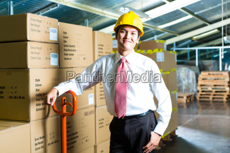 man in a warehouse with scanner