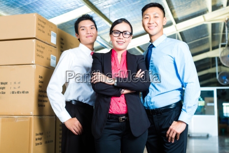 owners and businessmen in a warehouse