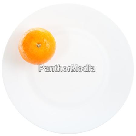 one orange on white plate