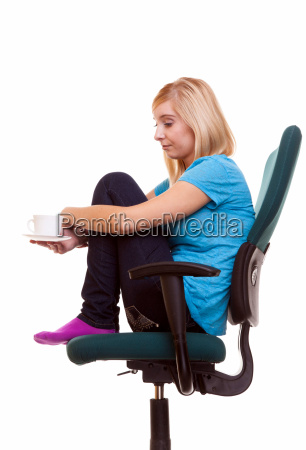 thoughtful girl relaxing in chair holds