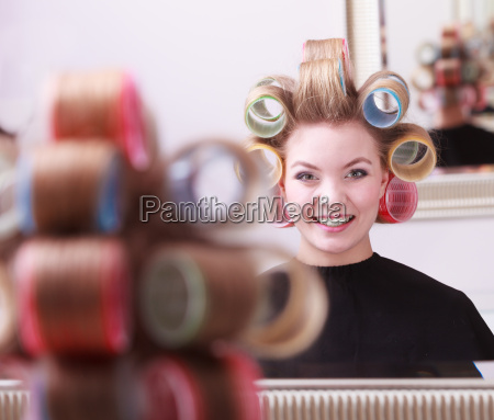 cheerful happy blond girl curlers rollers