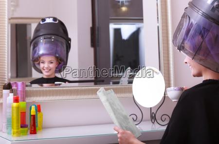 girl reading magazine drinking coffee hairdryer