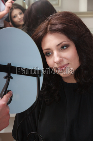 brunette woman with new hairstyle looking