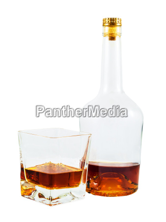 almost empty bottle and glass of
