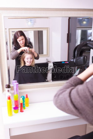 the beautiful blond girl hair curlers