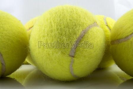close up three tennis balls