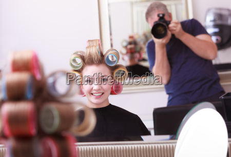cheerful happy blond girl hair curlers