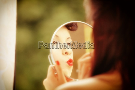 girl retro style applying make up