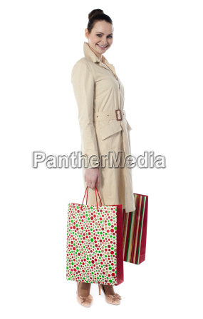 beautiful happy shopping woman holding shopping