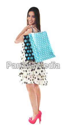 stunning teenager carrying shopping bags