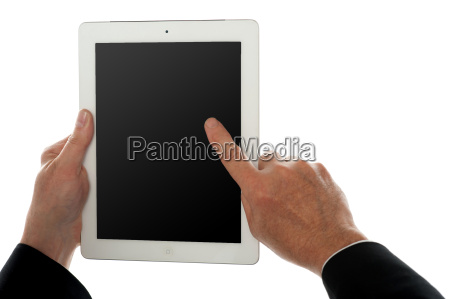 finger of a man on tablet