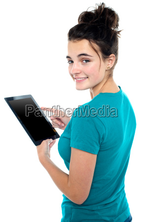 trendy young casual girl operating tablet