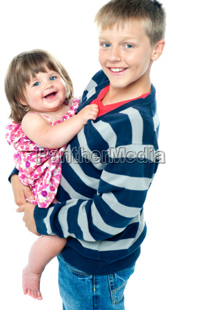 loving young brother carrying his sweet