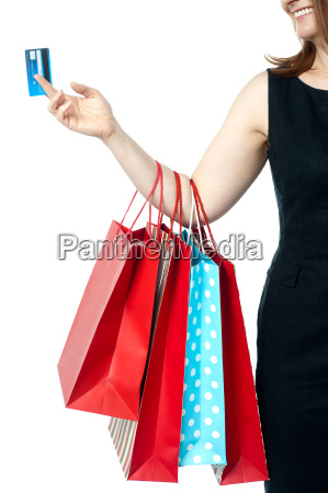 woman holding colorful shopping bags and