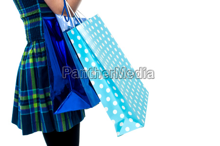 trendy girl with shopping bags cropped