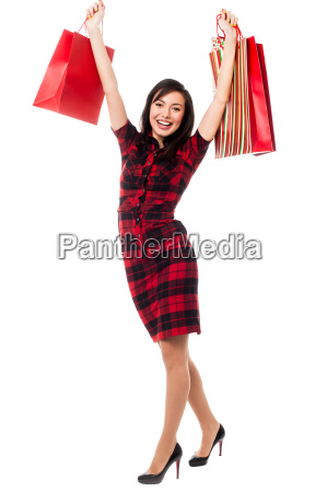 excited shopping girl having great fun