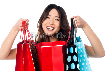pretty young chinese girl holding shopping