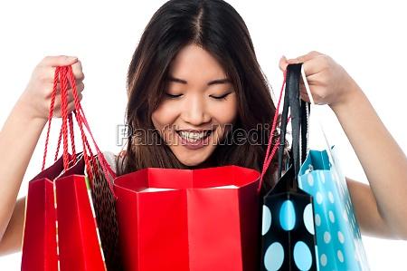 shopaholic girl holding shopping bags