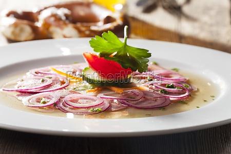 bavarian sausage salad on wood