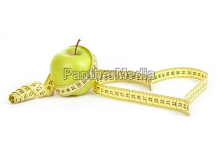 manzana verde con una cinta y