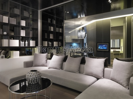 modern sectional sofa infront of mirror