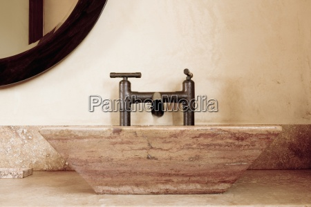detail of modern running faucet and