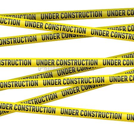 cinta de peligro amarilla bajo construccion