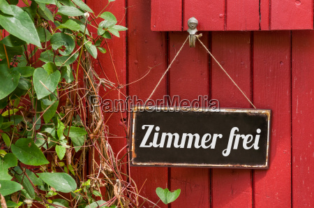 old metal sign with inscription available