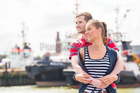 couple embracing at marina