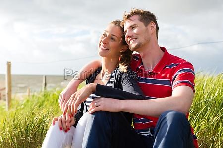 couple at ostseeurlaub in beach dunes