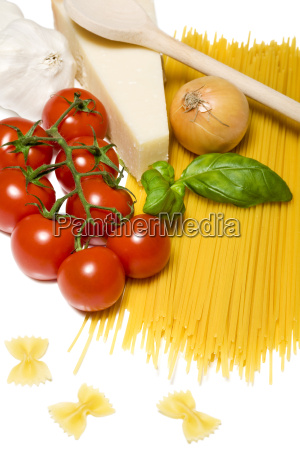 spaghetti and ingredients isolated on white