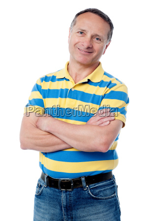 senior man posing with arms folded