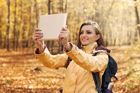 beautiful woman taking photo by digital