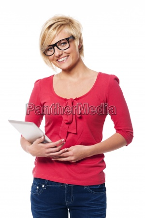 smiling woman with glasses holding digital