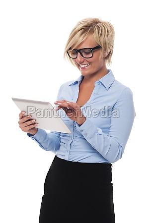 beautiful businesswoman wearing glasses using digital