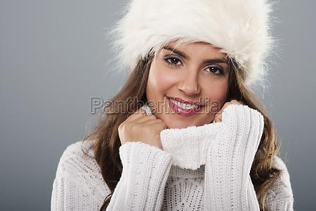 beautiful young woman wearing big fur