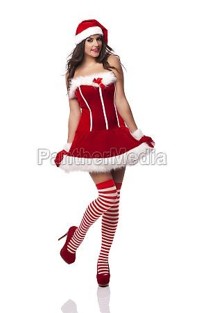 beautiful sexy woman wearing santa claus
