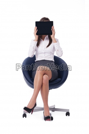 sitting businesswoman holding digital tablet