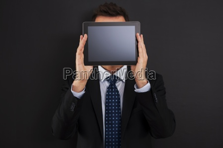 businessman holding digital tablet front of