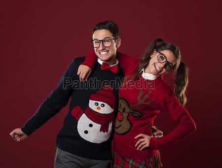portrait of nerd couple wearing funny