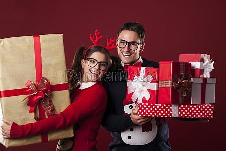happy nerd couple holding a lot
