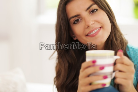 beautiful smiling woman with cup of