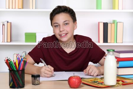 boy does homework at school