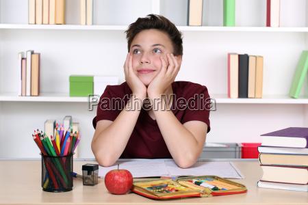 boy dreams in class at school
