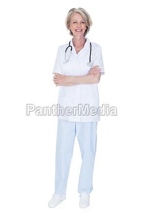 portrait of happy mature female doctor