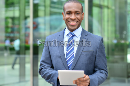 relaxed businessman using his digital tablet