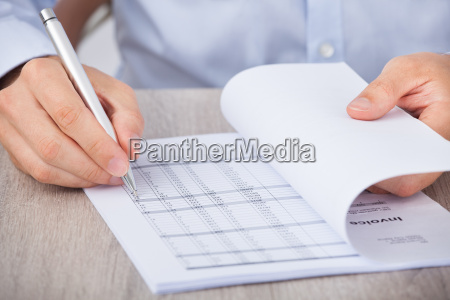 businessman calculating accounts